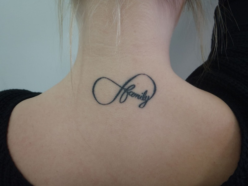 Infinity-dragon-tattoo-designs-on-upper-back-for-women