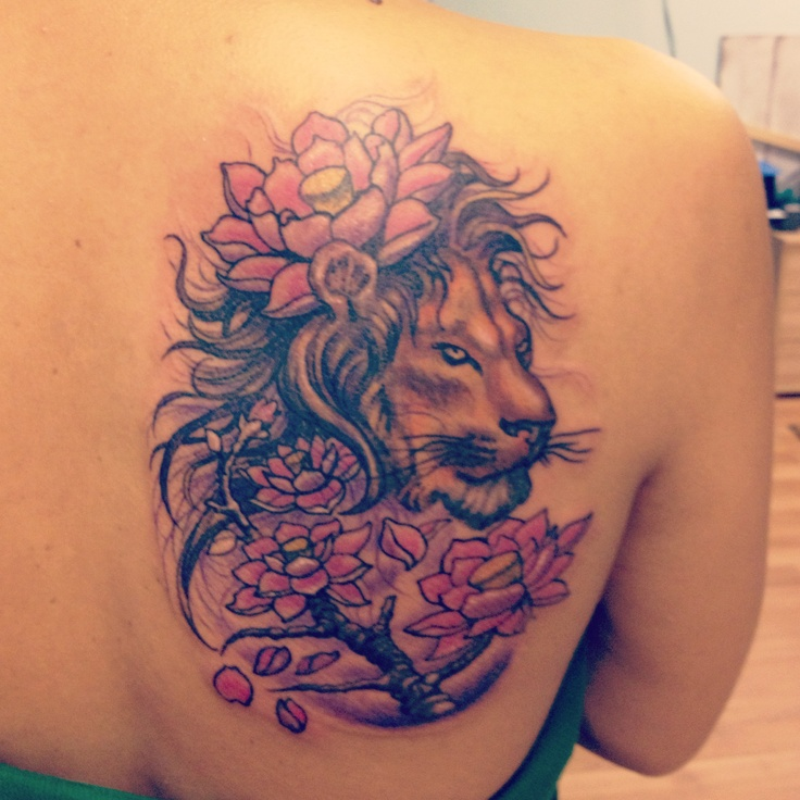 lion-with-flower-tattoo-for-women-on-back